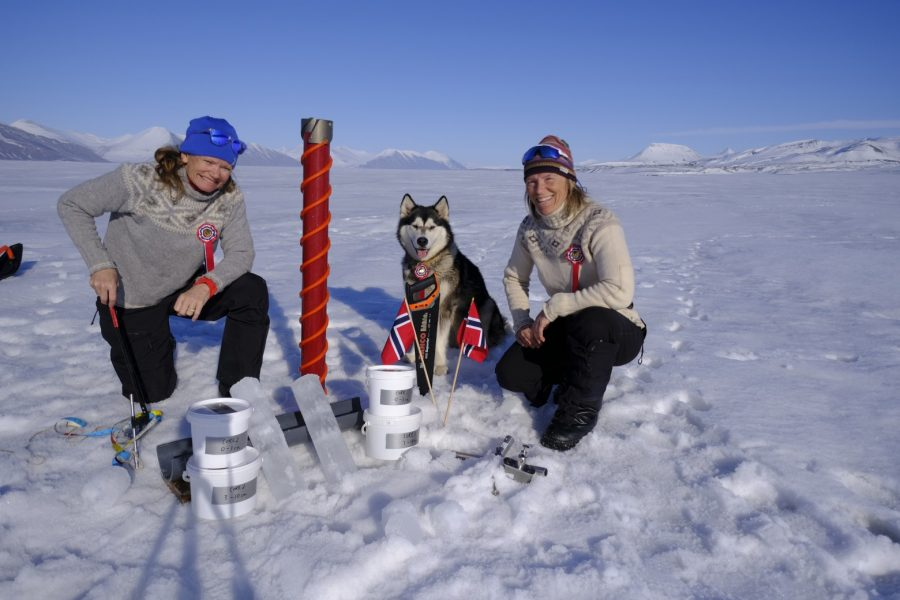 Two citizen scientists collecting ice samples in the Arctic
